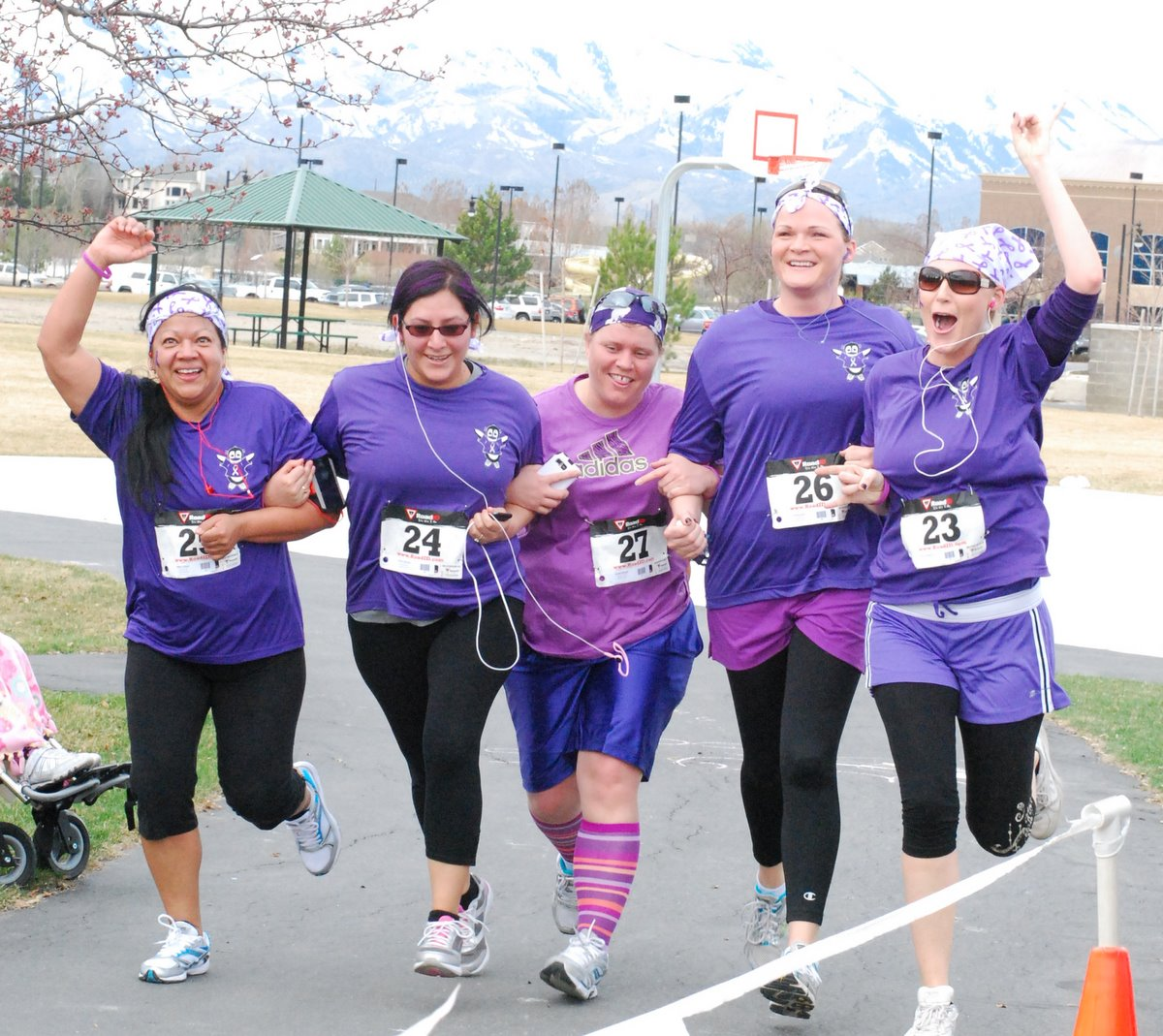 Bettina, Sandra, Charity, Christine and Mindy approach the finish line